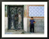 Boy Standing Near Door of Historic House  Baghdad  Iraq