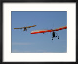 Hang Glider Being Towed Aloft by an Ultralight Aircraft