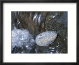 Rock with the Word Imagine in Rushing Water