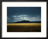The Setting Sun Permeates Rain Clouds to Brighten Black Rock Desert  Nevada