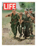 Wounded US Marine Helped to Safety by his Buddies During Fight with Viet Cong  July 2  1965