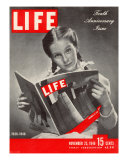 10th Anniversary Features Young Girl Reading First Issue of LIFE  November 25  1946