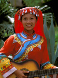 Ethnic Dancer Playing Guitar  Kunming  Yunnan Province  China