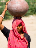 Local Woman Carrying Water Pot on Head  Village of Chakhsu  Jaipur  Rajasthan  India