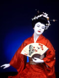 Close-up of Geisha Girl in Blue with Fan  Kyoto  Japan