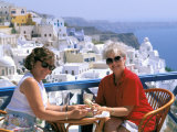 Women Having Coffee on Cafe Terrace  Santorini  Greece