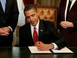 President Barack Obama Signs His First Act as President in the President's Room  January 20  2009