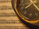 Close-Up of a Clock on Newspaper Stock Market Report