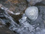 Stone with Word Smile in Water of Tranquil Stream