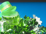Leprechaun Hat Atop St Patrick's Day Mug of Green Beer with Shamrock Decorations