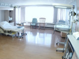 Hospital Bed  Chairs  and Medical Equipment Arranged in Empty Hospital Room