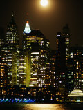 Building and High Rises of Manhattan  New York Skyline Illuminated by Lights at Night