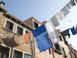 Lines of Laundry from Brick Houses Blowing in the Breeze