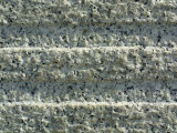 Close-Up of Parallel Horizontal Lines Carved in White Stone