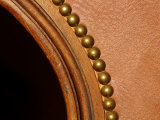 Close Up of Curved Brown Leather and Furniture Rivets
