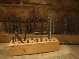 Assortment of Drill Bits in Wooden Blocks on Workbench