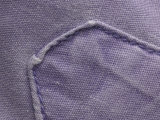 Close-Up of Fibers Woven in Purple Textile and Stitched Pocket