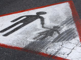 Paint Chipped and Tire Skid Mark on Yield Sign with Figure of Man Holding Hand of Little Girl