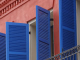 Open Blue Window Shutters on Ornate Building in New Orleans  Louisiana