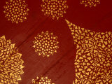 Decorative Gold Pattern on Ornate Red Textile