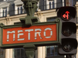 Sign for Metro with Traffic Signal Light in Paris  France