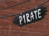Pirate Sign Hanging Near a Wooden Wall