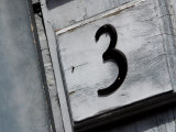 House Number 3 on a White Wall