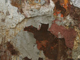 Peeling and Flaking Paint on a Rusted Steel Surface
