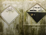 Danger Signs on Corrosive Chemical Tank