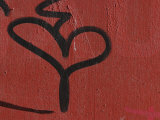 Graffiti on Red Concrete Wall