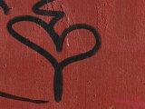 Graffiti on Red Concrete Wall