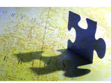 Puzzle Piece and Shadow Superimposed on Map