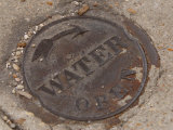 Weathered Water Manhole Cover