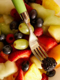 Fork in Salad with a Variety of Fruits Including Blueberries with Grapes and Melons