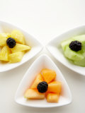 Variety of Fruit Dishes Including Blackberries and Cantaloupe