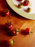 Fresh Red Cherry Tomatoes on Plate and Wood Table