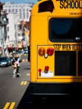 Rear View of School Bus Driving Along Street in San Francisco  California