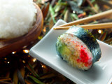 Traditional Japanese Cuisine of Sushi Rolls on Plate with Chopsticks