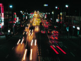 Blurred Motion of Cars on Busy City Street at Night with Illuminated Lights in Korea