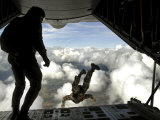 Pararescuemen Jump Out the Back of a C-130 Hercules