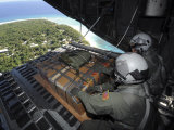 Airmen Push Out a Pallet of Donated Goods over the Island of Yap from C-130 Hercules  Dec 19  2008