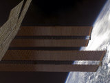International Space Station&#39;s Solar Array Panels and Earth&#39;s Horizon