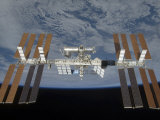 International Space Station  Backdropped by the Blackness of Space and Earth&#39;s Horizon