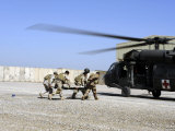 Soldiers Rush a Simulated Casualty to a UH-60 Blackhawk Helicopter