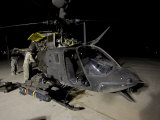 Maintenance Crew Works on Servicing the OH-58 Kiowa before its Next Mission