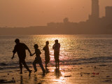 Silhouetted Figures on Chowpatty Beach  Mumbai  Maharashtra State  India