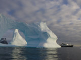 National Geographic Endeavour Framed in a Beautiful Iceberg Arch  Antarctic Peninsula  Antarctica