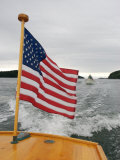 Flag Waves on the Stern of a Maine Made Hampton Yacht  Kennebec River  Bath  Maine  USA