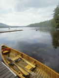 Canoe Floats Next to a Dock  Sebago Lake  Maine