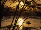 Water Taxi Ferries Passengers across River at Sunrise  Rio Madre de Dios  Puerto Maldonado  Peru